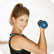 Image of woman lifting weights.